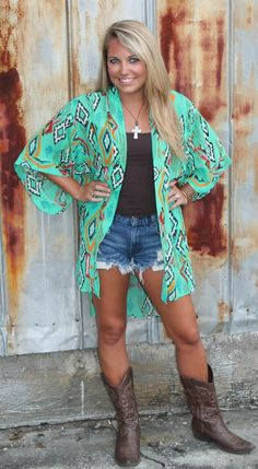 $32 This lightweight cardigan is 100% polyester. It is a silky material with a hi-lo hemline! A great cardigan to make a statement!!