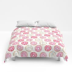 Pink Donuts Comforters. Pink iced (frosted) donuts drawn with pen, watercolours and pencils and finished digitally - design by Hazel Fisher Creations.  Available on comforters and other products from Society6.