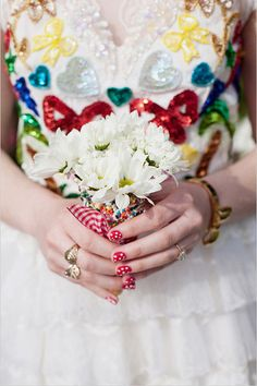 why not add some brightly colored sequins to your wedding dress? who says it has to be completely white!
