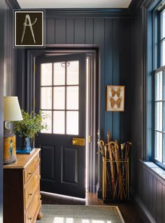 Beautiful kitchen entrance. Walls repeat blue of cabinets...door hardware is such a nice detail.