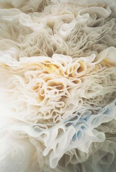 I love ruffles, long girly skirts and dresses and a coverlet of this would look so pretty on a bed.