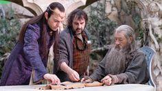 Sir Ian McKellen, Peter Jackson, and Hugo Weaving on the set of The Hobbit.