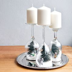 Head to the dollar store and pick up a collection of wine glasses, a box of sugar, and a few kitschy holiday figurines — or even plastic ornaments — for making these easy holiday dioramas.