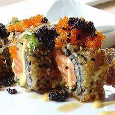 deep fried salmon roll with rasani sauce with fresh caviar on top.