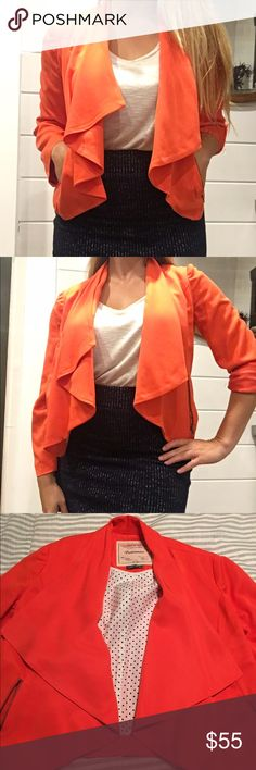 Anthroplogie jacket. Very flattering!! Drape front, open jacket. Waist length. Outer zipper pockets. Crop sleeve length that can be worn down or rolled up with a snap. The cutest polkadot lining! Size small. Color is an orange- melon. Anthropologie Jackets & Coats