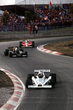 An impeccable Alan Jones leads an oversteering Jody Scheckter and Gilles Villeneuve at Montreal 1978