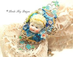 The Secret Garden Ring Doll Head Mixed Media Statement Avant Garde Jewelry Art Ring Lorelie Kay Original One-of-a-Kind Mixed by loreliekaydesigns on Etsy https://www.etsy.com/listing/265099959/the-secret-garden-ring-doll-head-mixed