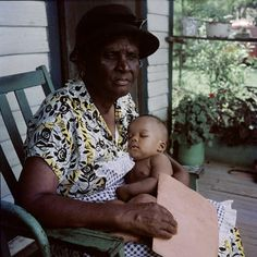 This woman looks like she is taking care of this child who could be her grandchild.   Segregation era Alabama, c. 1956: Photo exhibition of Gordon Parks' portraits at the Schomburg Center of the NY Public Library