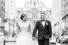 bride and groom in tuxedo walk around downtown Philadelphia @myweddingdotcom