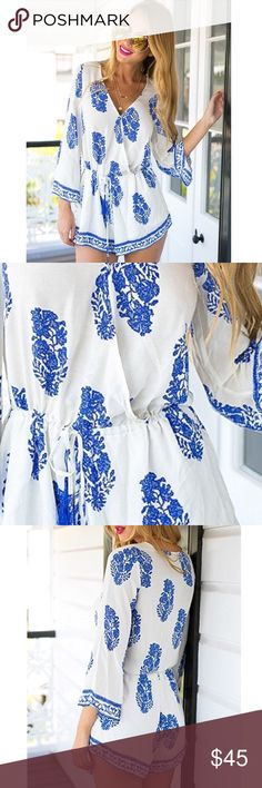"""Floral V Neck Long Sleeve Boho Blue White  Romper New Floral V Neck 100% Cotton Long Sleeve Boho Chic Cinched Waist Drawstring Adjustable Blue and White Romper. Runs true to size. Machine washable.  Small – 35"""" bust / 24""""- 30"""" waist / 31"""" length Medium – 36"""" bust / 25""""- 31"""" waist / 32"""" length Large – 37"""" bust / 26"""" - 32"""" waist / 33"""" length  Bundle two or more items and get 20% off your entire order. Pants Jumpsuits & Rompers"""