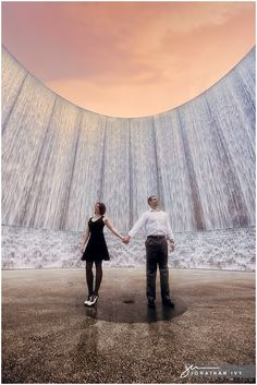 This is an amazing picture! I love the evening sky and how it looks as if you're looking up at the couple and the waterwall.