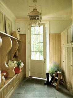 Want bluestone floor like this in our sunroom. Mudroom w/ bluestone floor and Paul Ferrante lantern; Suzanne Kasler design