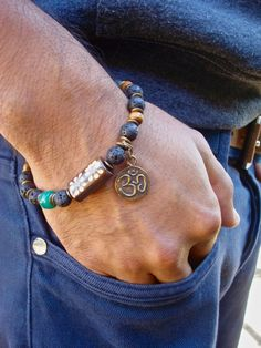 Mens Om Good Fortune bracelet with Black Lava, Recycled Green Glass, Antique Tibetan Bronze Om double sided, Carved Bone, Wood, Brass - Yoga by tocijewelry on Etsy