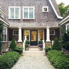 What's the first word that you think of when you see this stunning home that belongs to Sandra Cavallo Grey Exterior, Exterior Colors, Exterior Design, Beach Cottage Style, Beach House, Shingle Style Architecture, White Shiplap Wall, Bedroom Nook, Ship Lap Walls