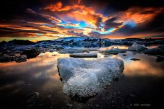 Ice and Fire  a memorable sunset experience where the sky is literally under fire to illuminate the icy land of Jokulsarlon.  Please view on black and full screen to see the details.  Jokulsarlon, Iceland September 2013