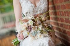 Dusty pink and cream bouquet with feather and lace accents