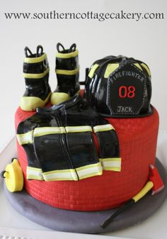Firefighter Jacks bday cake - My turned 8 this week and he wanted a firefighter themed cake. I decided to make a cake that had some of the things firefighters would use rather than a big fire truck cake. He loved it and I had a great time making it.