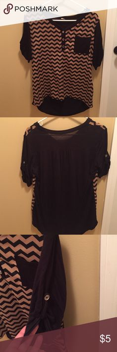 Black and Tan chevron shirt 50% polyester and 50% cotton, mid upper arm length sleeves, polyester in the front and cotton on sleeves and back, 3 buttoned v neck blouse/shirt. Worn to work with black dress pants. Higher in the front, longer in the back. Tops Blouses