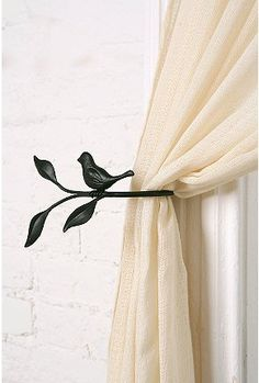 Curtain tie-backs for curtains over the door