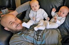 Travis Fimmel with costar Amy Bailey's twins on set of Vikings