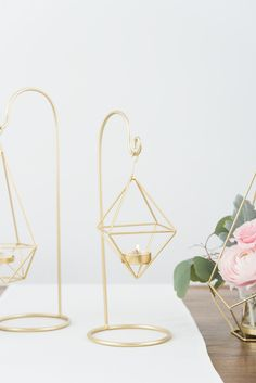 Small Gold Geometric Hanging Tealight Holder-  This versatile hanging tea light holder makes a stunning centerpiece element that will dress up any special occasion.