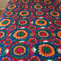 Colorburst afghan with red, blue, orange, and green granny circles READY TO SHIP