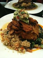 Chili-lime grilled Seitan with roasted vegetable quinoa pilaf, sautéed greens and avocado salad. Served with black bean sauce and chipotle coulis at Candle Cafe in New York City