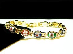 New Listings Daily - Follow Us for UpDates -  Sizzling Summer Deal! Oval Flower Link Bracelet in Multi Colors of Green, Blue, Black and Rustic Red - #Vintage #Jewelry offered by #TheJewelSeeker on Etsy  Style:  Petite ova... #vintage #jewelry #teamlove #etsyretwt #thejewelseeker ➡️ http://etsy.me/2vv6Zt4
