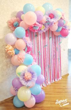 A balloon photo backdrop! I love these pastel colours and the tissue flowers!