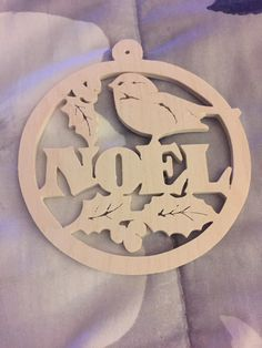 Scroll saw round wooden Noel Christmas tree ornament with holly and a bird by…