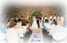 06-17-06  From the back of the Venue and put writing on the isle runner with their names and wedding date........(we actually had a heart shape on the runner but it didn't show when this picture was took----so I put printed it in with some special effect options)