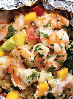 Shrimp with Avocado-Mango Salsa. This is the perfect seasonal seafood meal! Under 400 cals and only 10 grams of fat; can't wait to foil this up and try it!