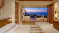 From any of the four bedrooms in this private villa, you're treated to incredible ocean views thanks to open walls and multiple outdoor spaces. The interior takes its design cue from its natural surroundings, featuring warm wood and fresh white accents.