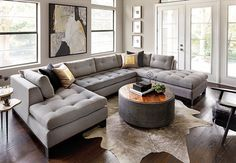 High Fashion Home - I like the configuration of the couch, round table and wooden chair with leather.