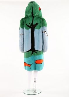 A Christian Dior pictorial intarsia mink coat, 1980s. Paris labelled, with central black mink tree with dyed green canopy/hood, red apples, and a pond with fishes to the hem, sea-gulls in a blue sky lined in black silk. http://kerrytaylorauctions.com