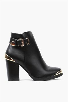 GORGEOUS!  Love these boots.  The whole shape and they're a great heel height.