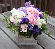 Flower box with roses, lisianthus, stock, wax, and green fillers. A great floral gift in a wooden box.