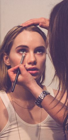 British model Suki Waterhouse backstage preparing for the Shanghai celebration with Burberry beauty
