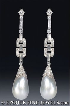An exquisite pair of Art Deco natural pearl and diamond platinum earrings. Circa 1925.