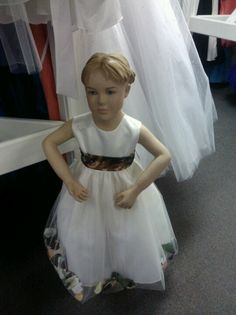 Camouflage flower girl dress with camouflage color flower pedals in it... soo cute