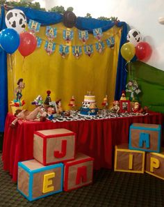 Toy story cake table for unisex bday party. Used Pinterest ideas and this was the result