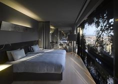 Jean Nouvel's Barcelona Hotel has leafy windows and a plant-filled atrium