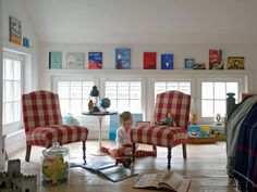 Colorful children's books propped up on the window frame is a great alternative to artwork! #kids