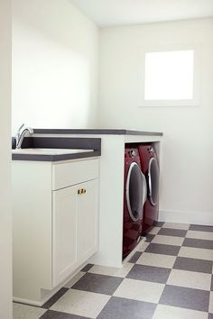 Laundry room- I don't like the floor so much and the color of the countertops should match the color of the washing machines.