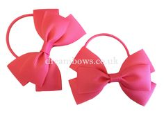 Bright pink grosgrain ribbon girls hair bows on thin bobbles - www.dreambows.co.uk pinkbows, hairbows uk, uk hairbows for sale, shop for pink hair bows, girls hair, baby bobbles, toddler hair bows