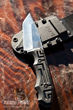 "SOG Growl, designed by knife maker Jason Brous. Total Length: 8.1"" Blade Length: 3.6"" Weight: 5.40oz. Blade Thickness: .25"" Steel Type: 9CR18MOV. Photo Credit: Zero7One."