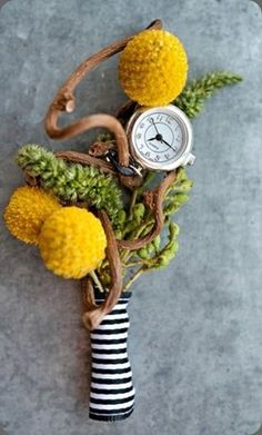 Craspedia boutonniere with watch naturalwood elemnts./ centralflweddingflowers/ www.callaraesfloralevents@yahoo.com
