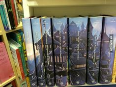 Italian edition of Harry Potter series... When all 7 books are held together in order, a castle can be seen on their combined bookspines