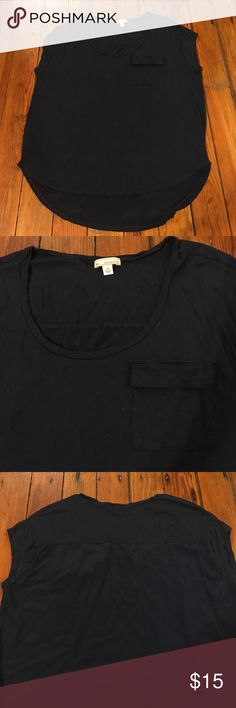 Gap Tee with Cap Sleeves Loose fitting top with a longer back than the front. It also has a cute little front pocket! Great condition! GAP Tops Tees - Short Sleeve