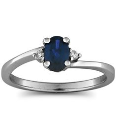 .63 carat total weight diamond and sapphire prong set birthstone ring with a .58 carat oval shaped sapphire center stone and .05 carat total weight diamonds set in 10k white or yellow gold.